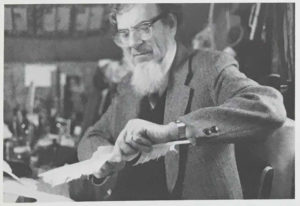 Dr. Eric Ray carving a quill pen